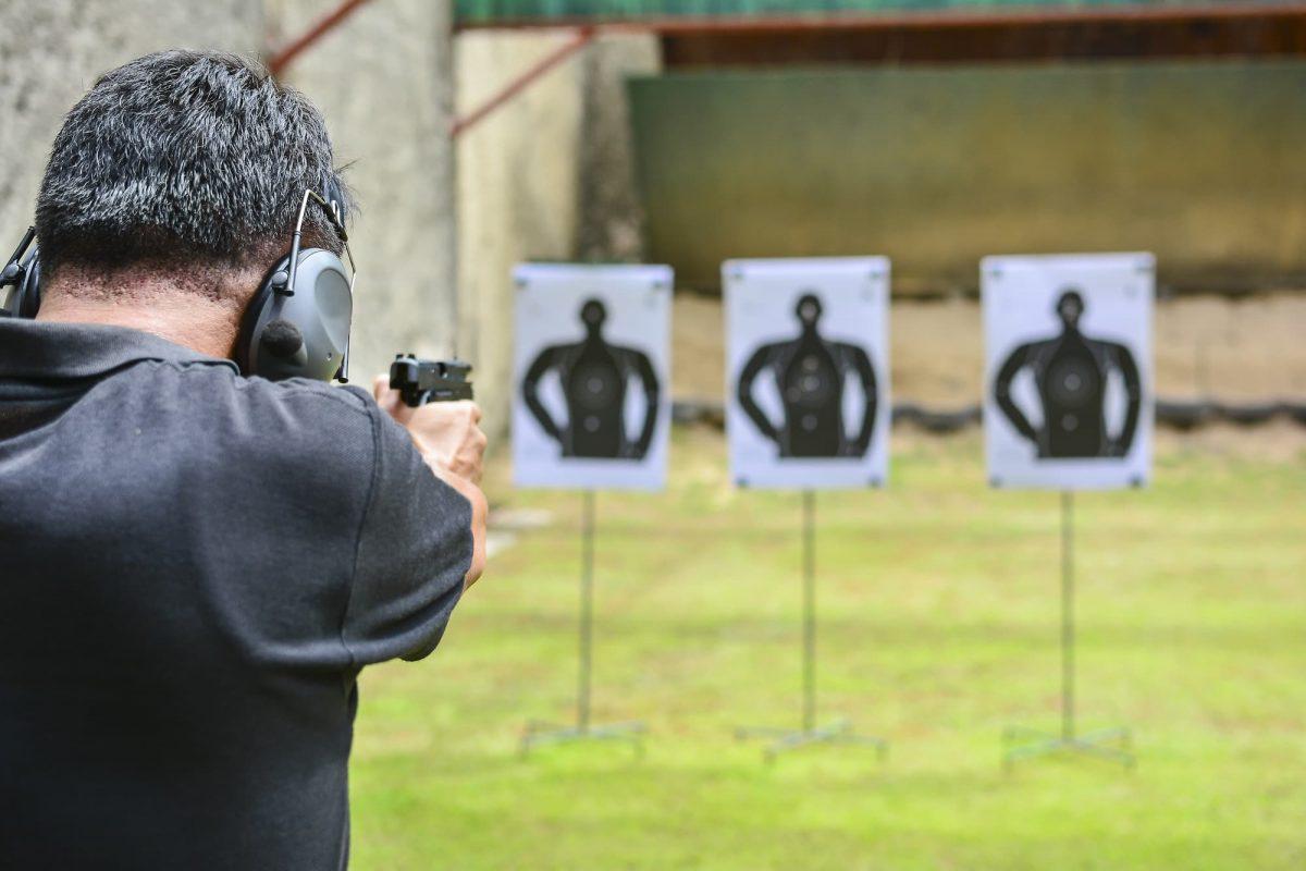 man taking aim at targets downrange